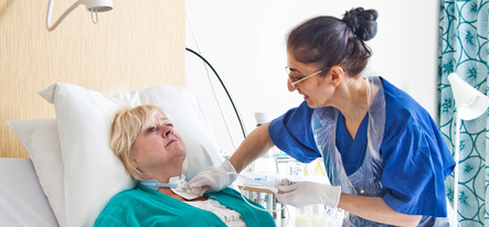 Patient with nurse in patient room